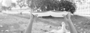 Header - Resources Relaxing Person Reading a Book